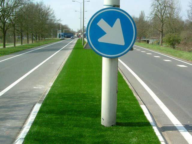 Median with lights and signs on artificial turf