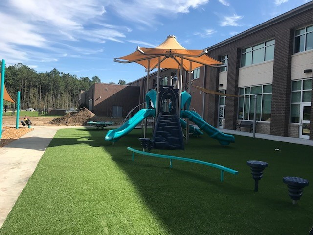 Bowens Corner playground slide on artificial grass