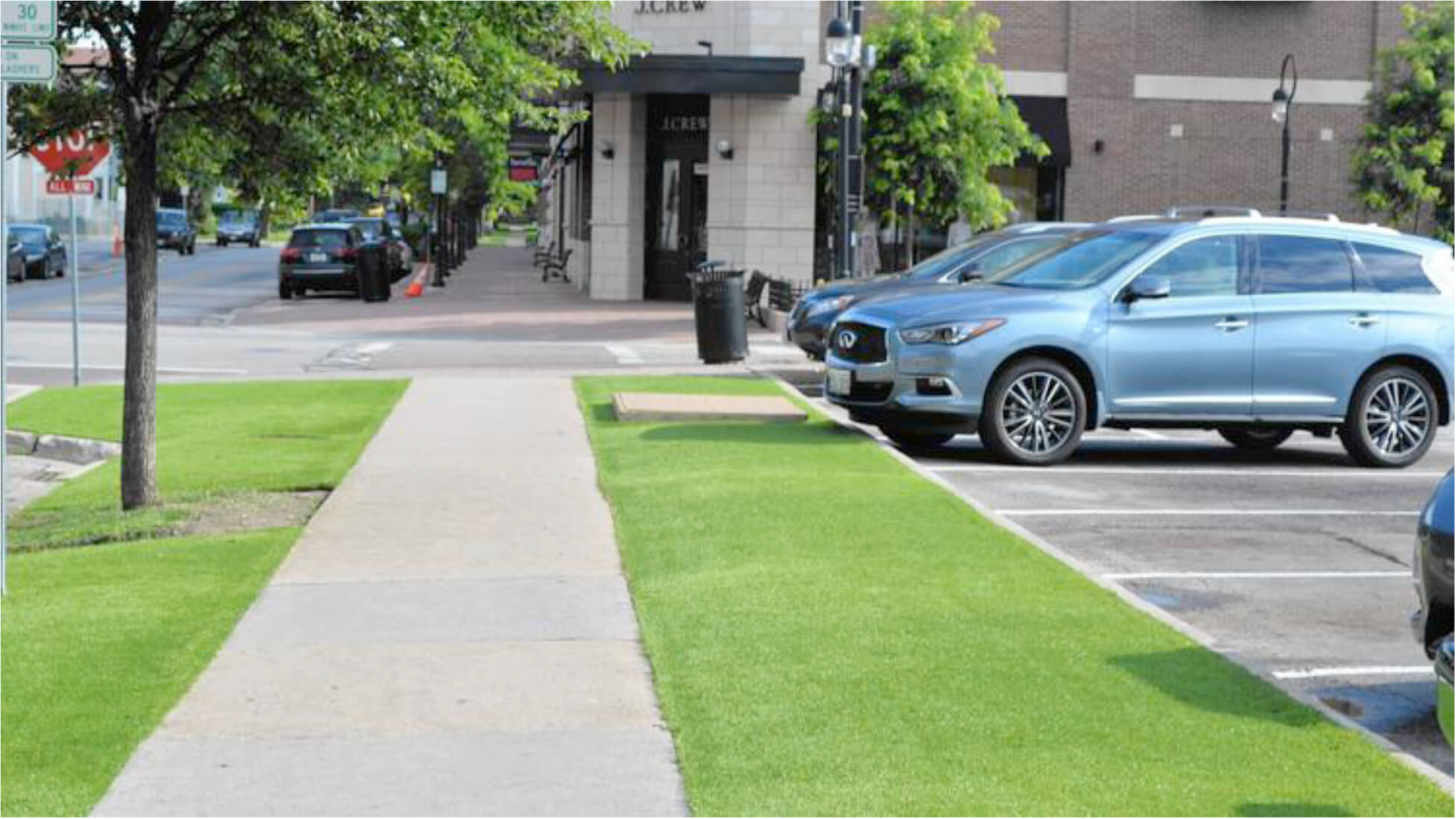 City of Naperville artificial grass next to parking lot