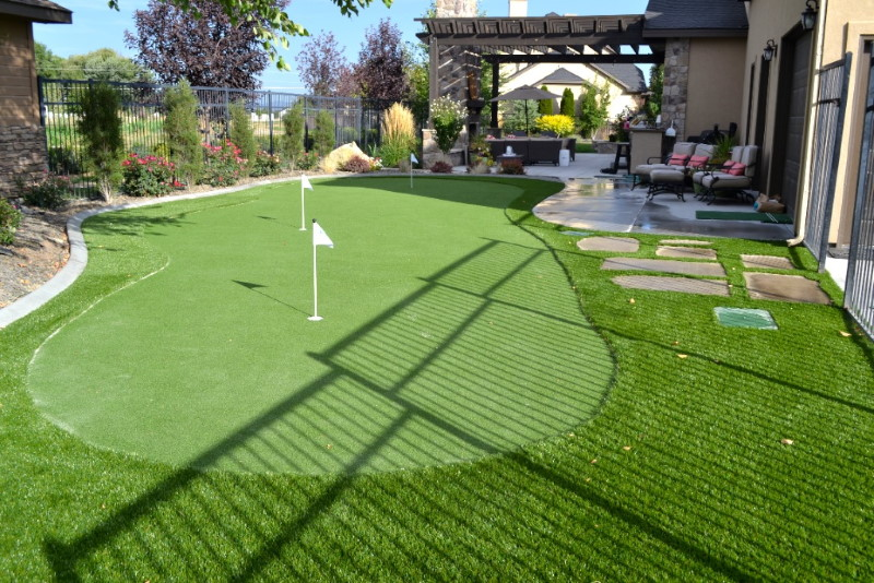 Backyard putting green with 3 holes