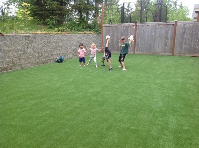 Dzingle happy kids after new grass installation