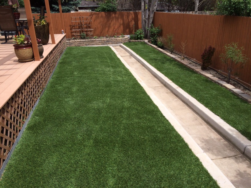 artificial grass next to patio in yard