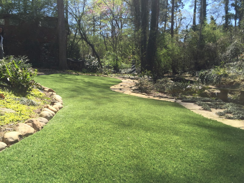 landscaped yard with fake grass
