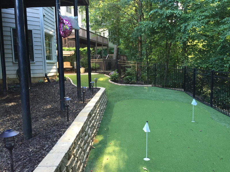 Putting green on the side of a house