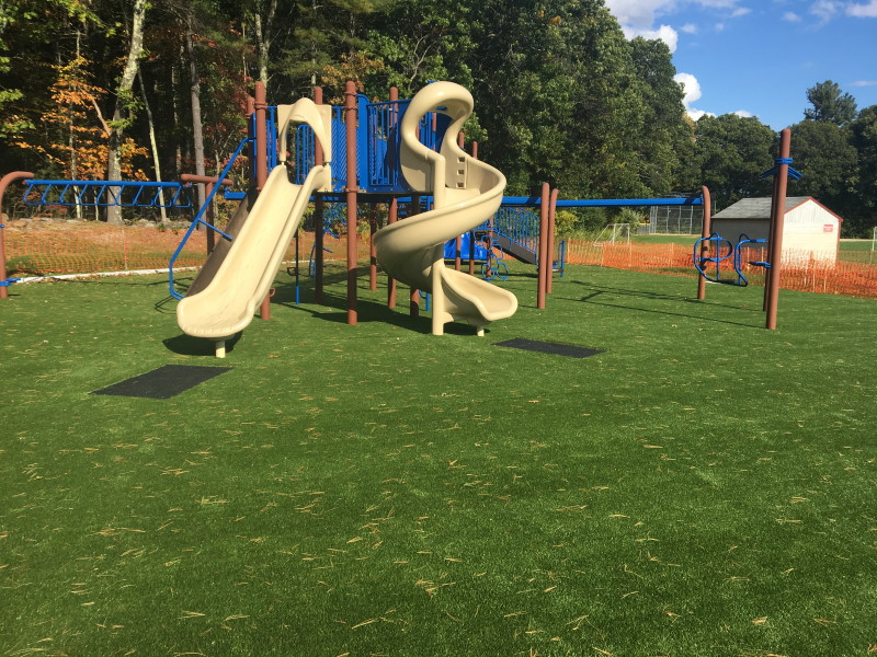 Spofford School slide on artificial grass