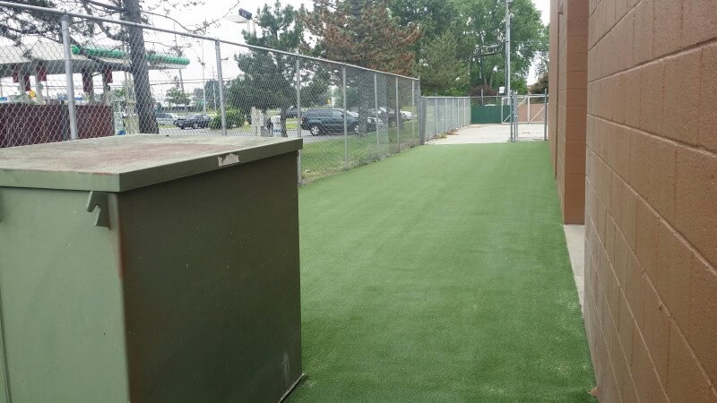 Dirt Paws fenced in artificial turf installation