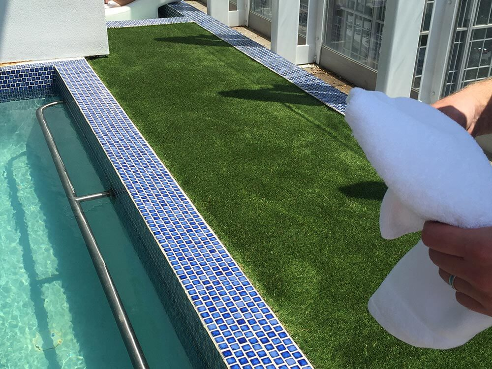 Commercial hotel poolside with artificial turf