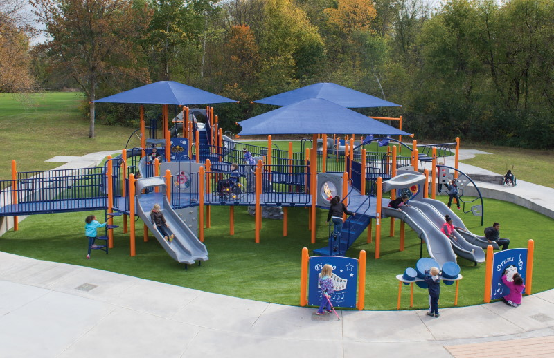 Northwoods park playground with kids playing on artificial turf