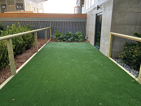 Commercial space with artificial turf.