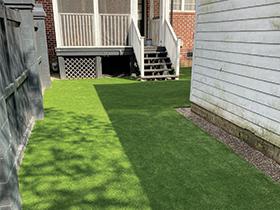 Low maintenance artificial grass yard