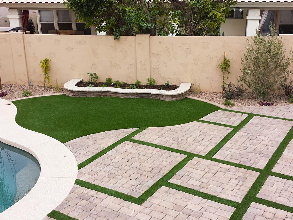Paver walkway with artificial turf