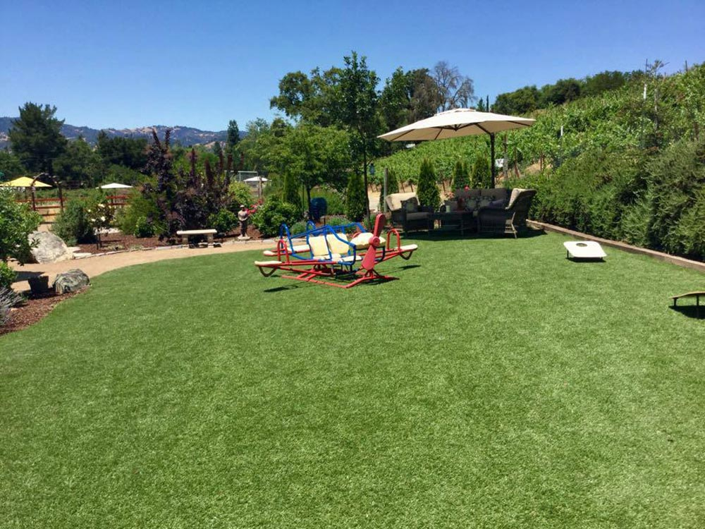 Fake lawn backyard with seating and games