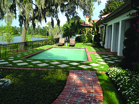 Pool area with turf and pavers Windermere, FL