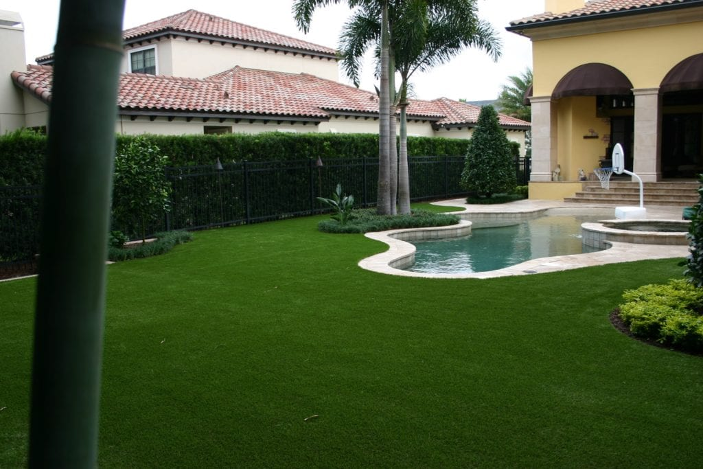 artificial turf orlando backyard with pool