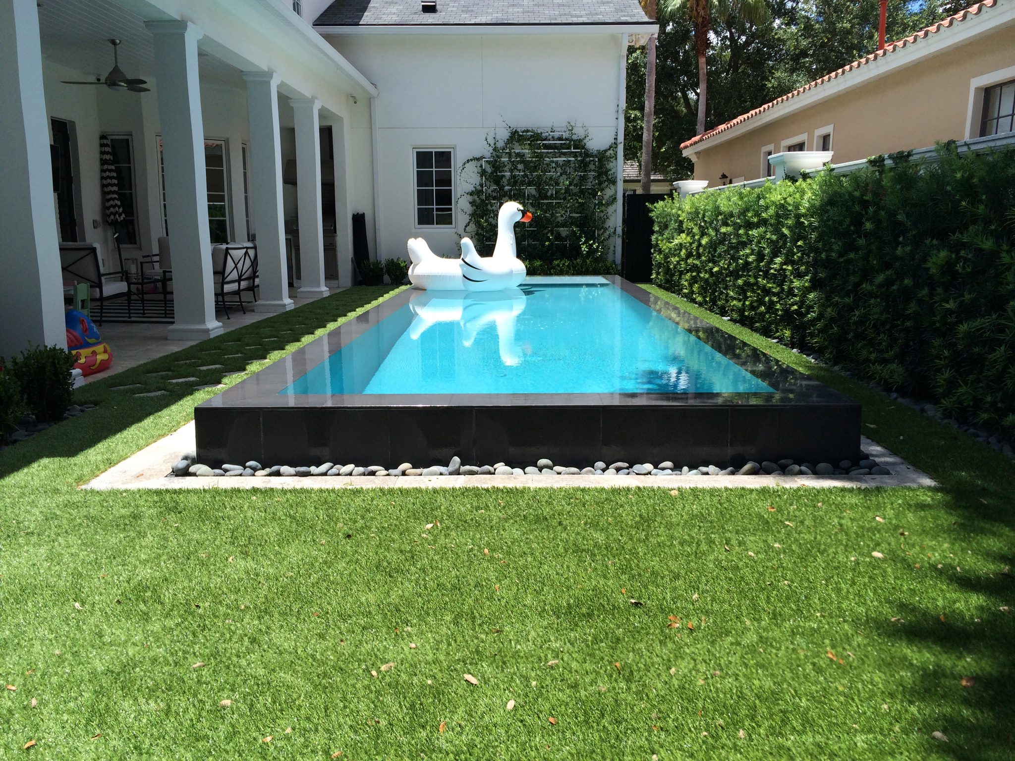 synthetic lawn backyard with raised pool
