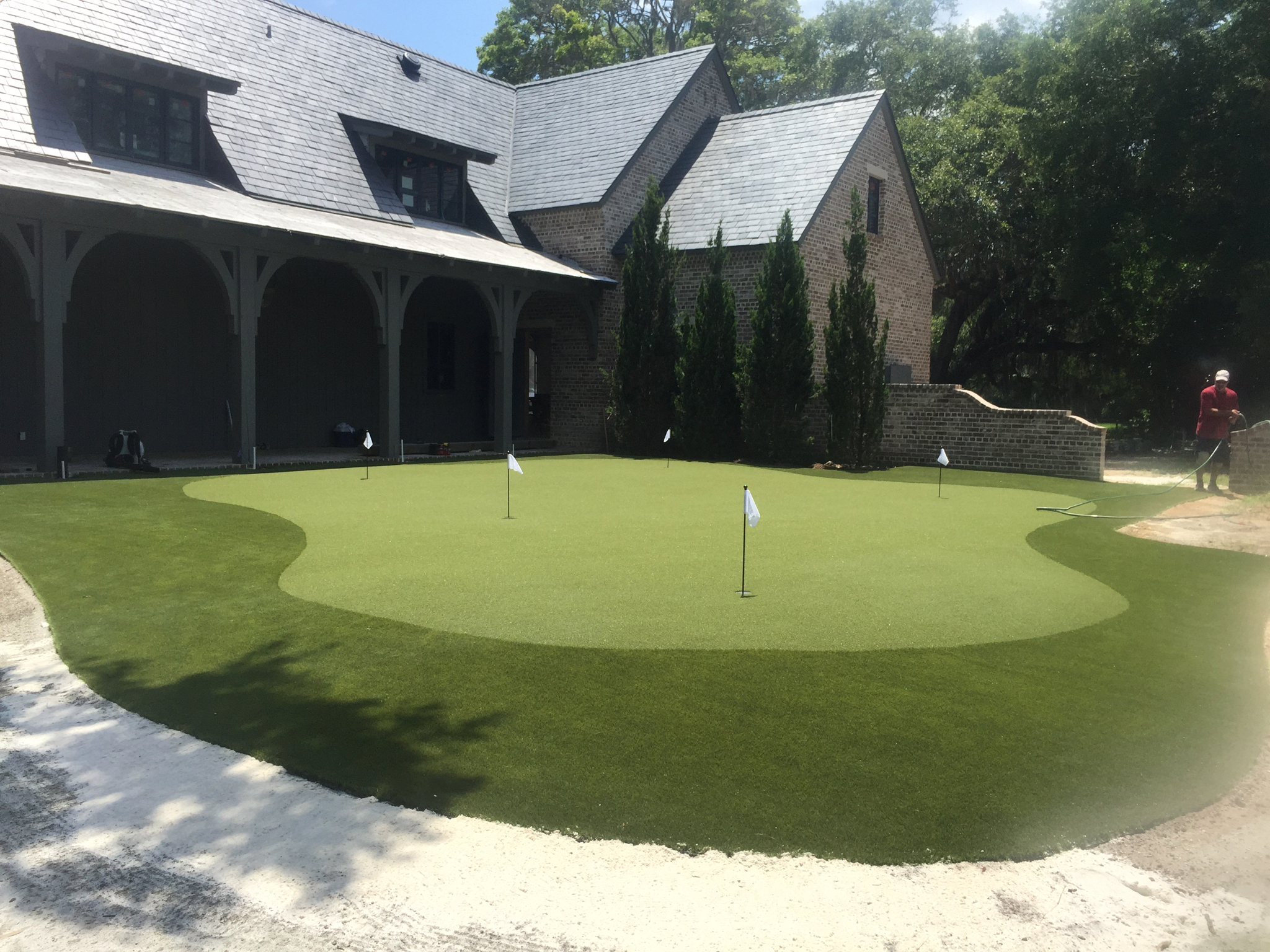 large backyard putting green and fringe with sand traps in orlando