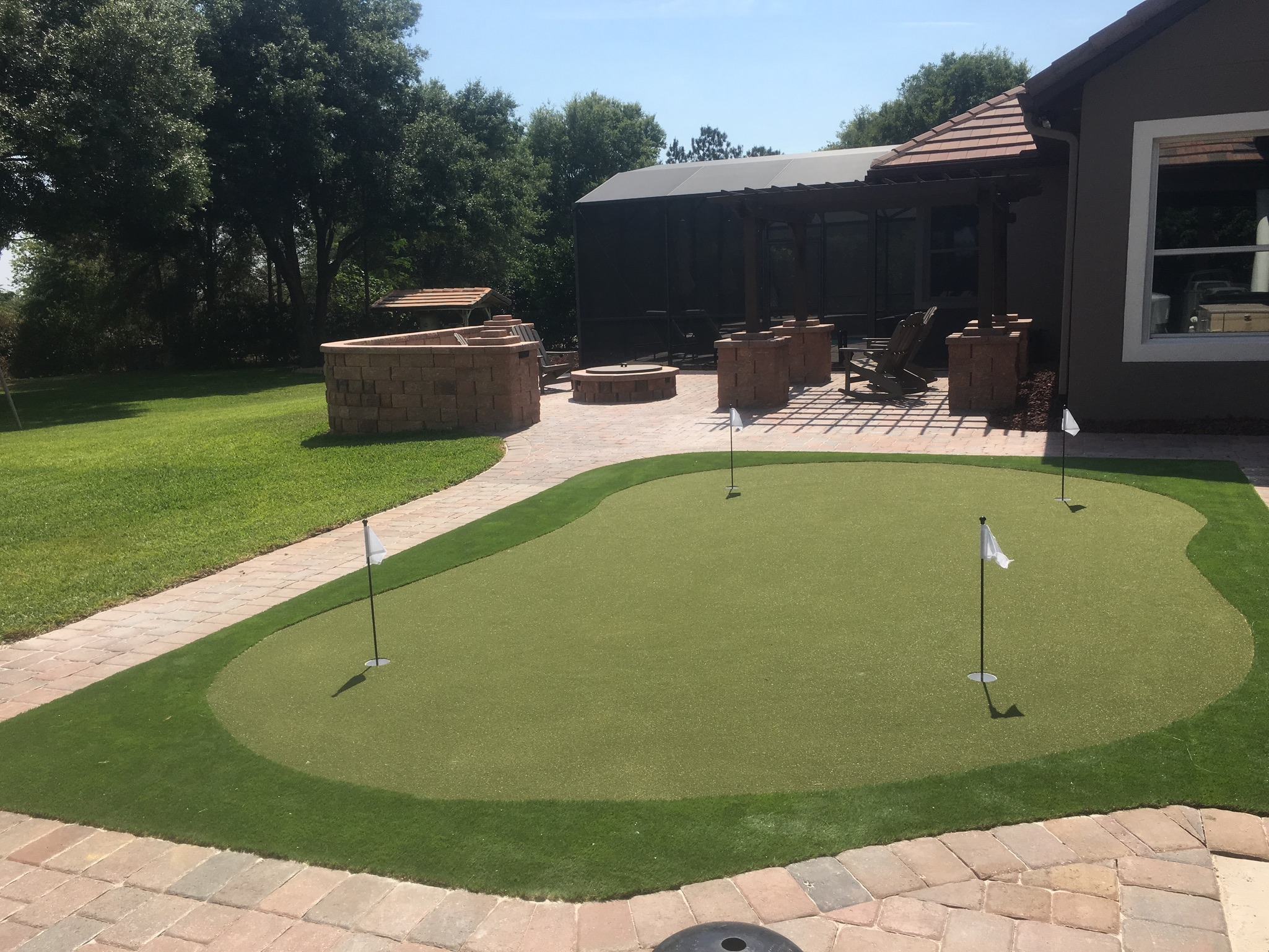 putting green with fringe near deck and walkway in orlando