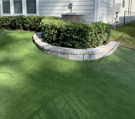 Artificial Grass around yard shrubs
