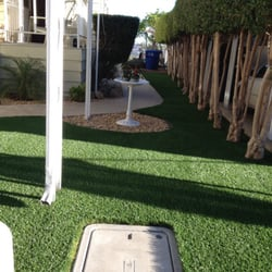 Landscaped artificial turf yard