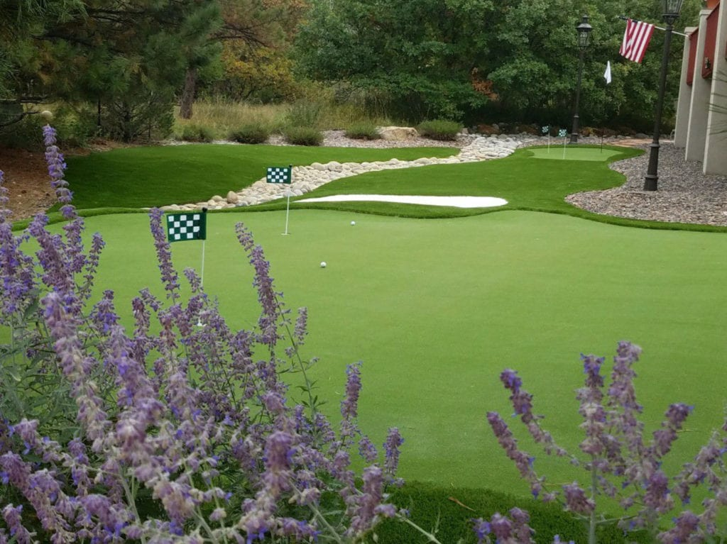 Large complex putting green with sand traps and multiple holes