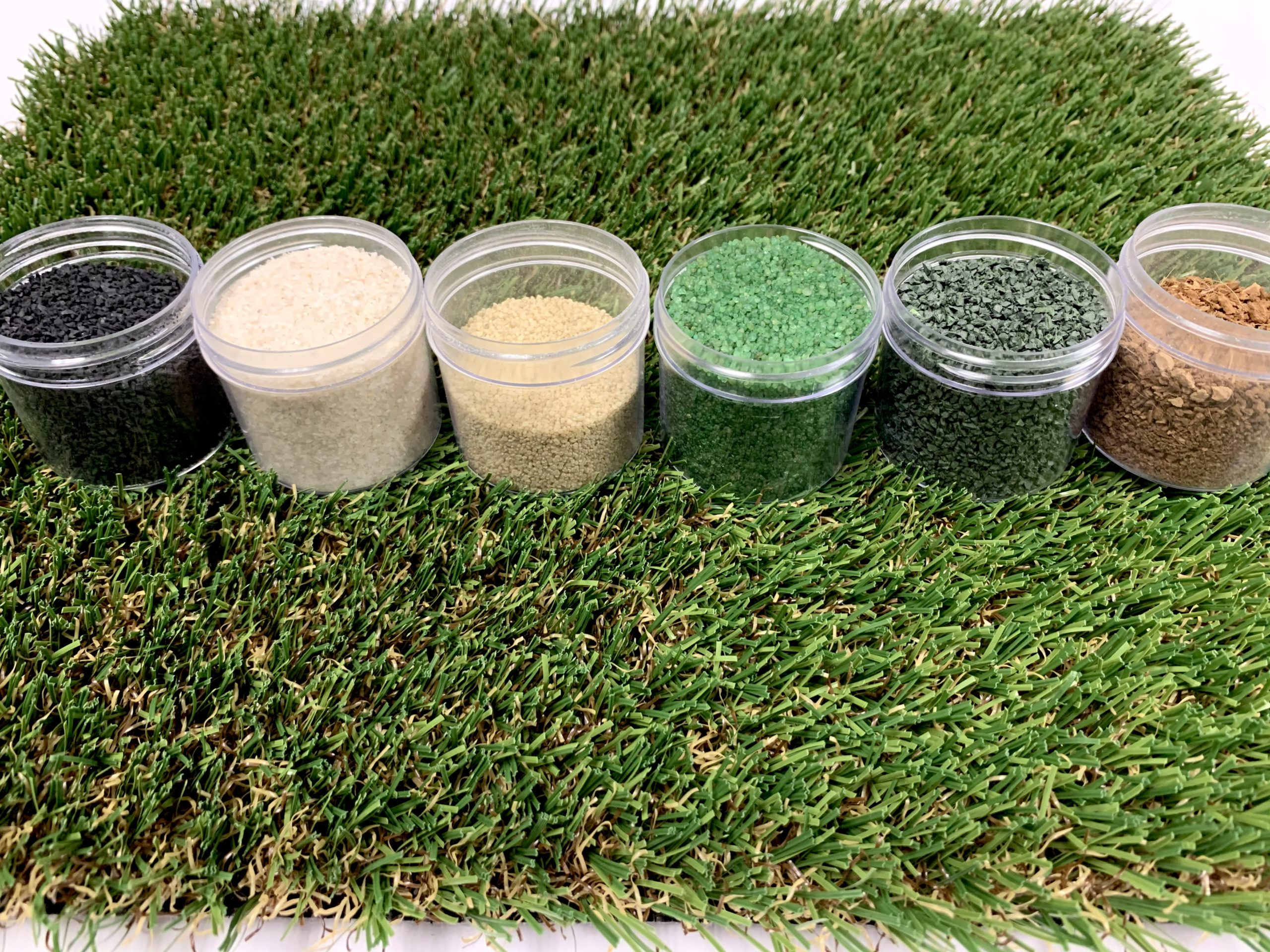 Varying types of infill in containers on turf
